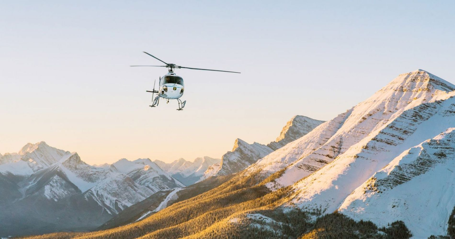 Helicopter flight over Rocky Mountains, Alberta