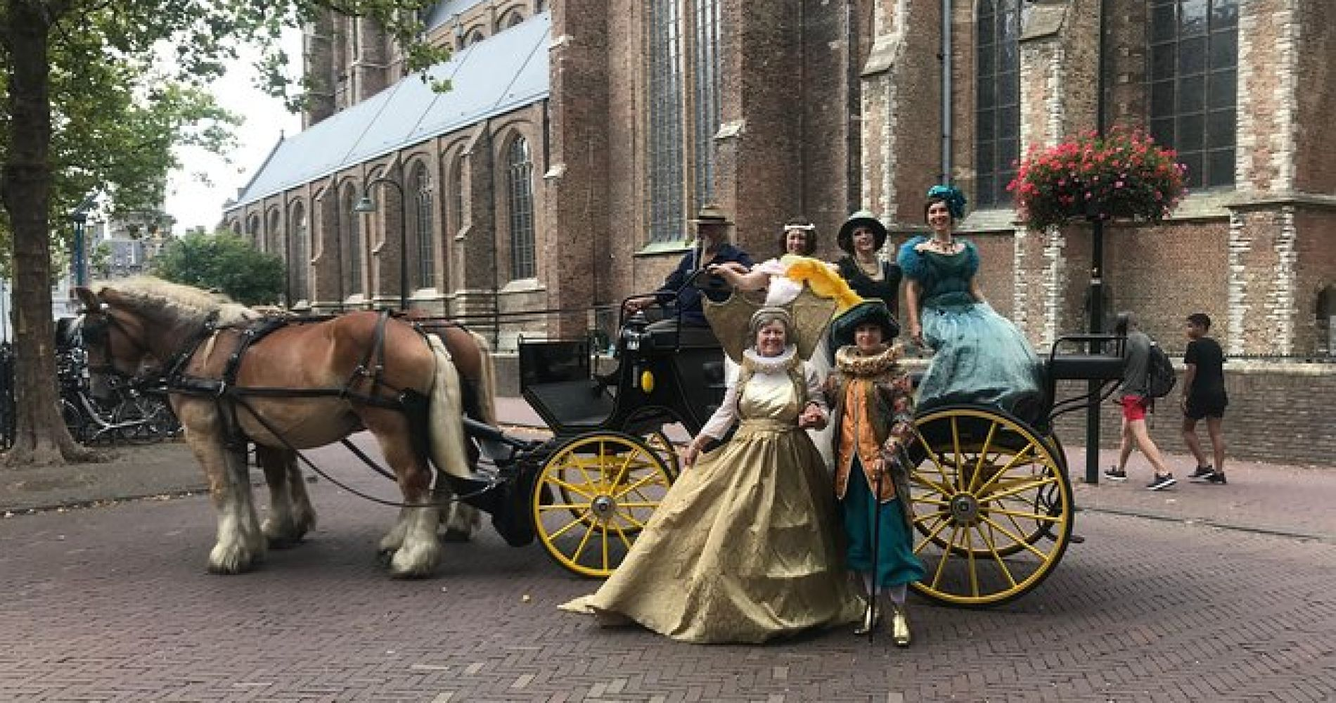 Tour with guide on a horse tram or horse-drawn carriage through historic Delft