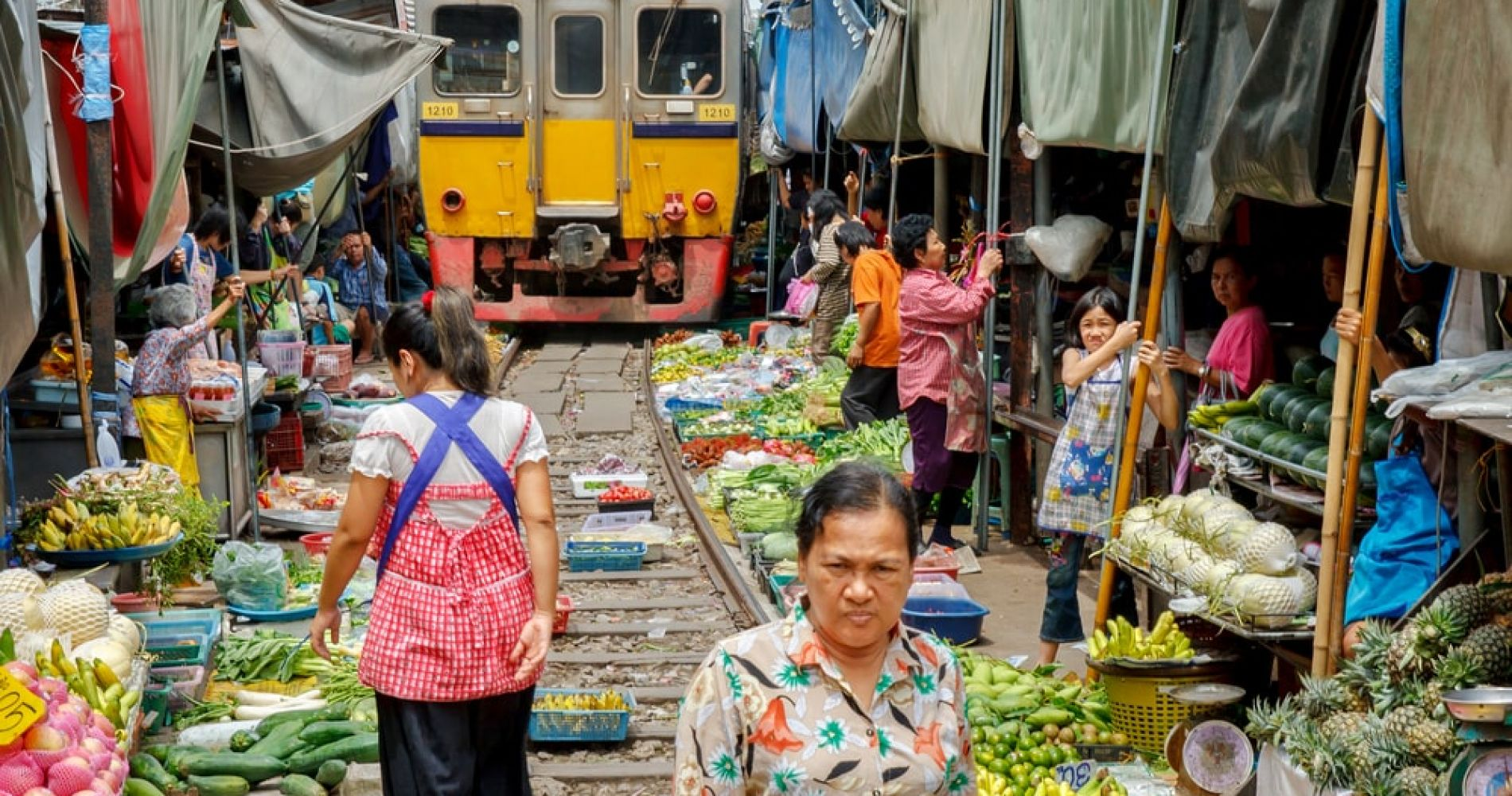 Explore the Famous Maeklong Railway Market in Thailand