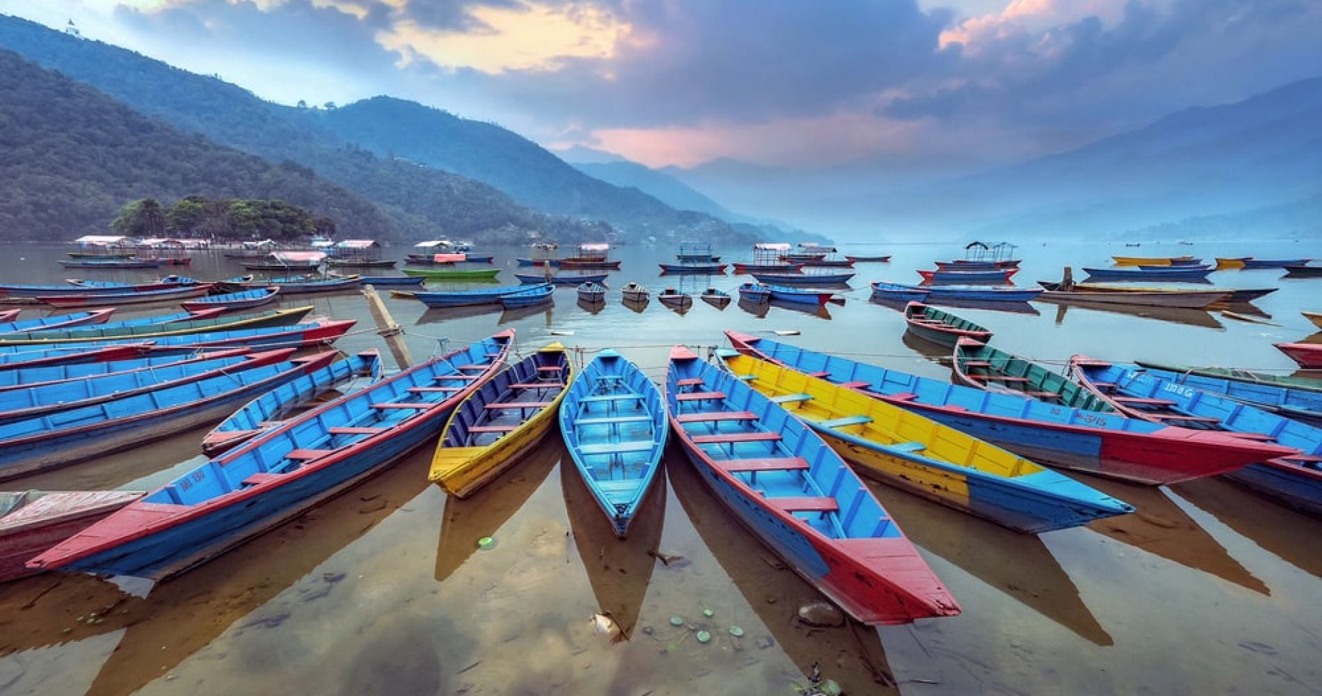 Stroll (or canoe) along Pokhara lake surrounded by the breathtaking Annapurna mountains in Nepal