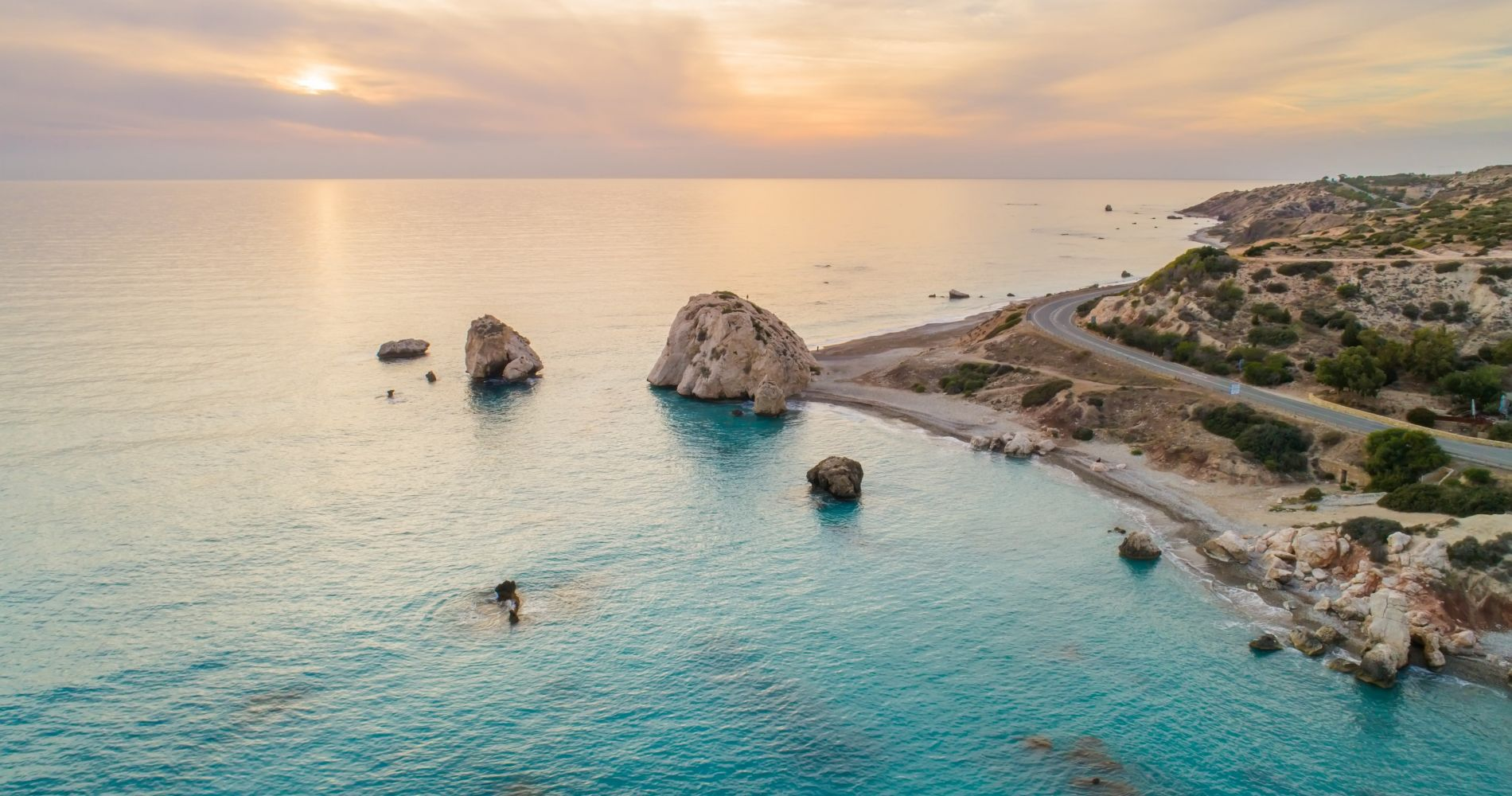 Swim next to Aphrodite's Rock in Cyprus